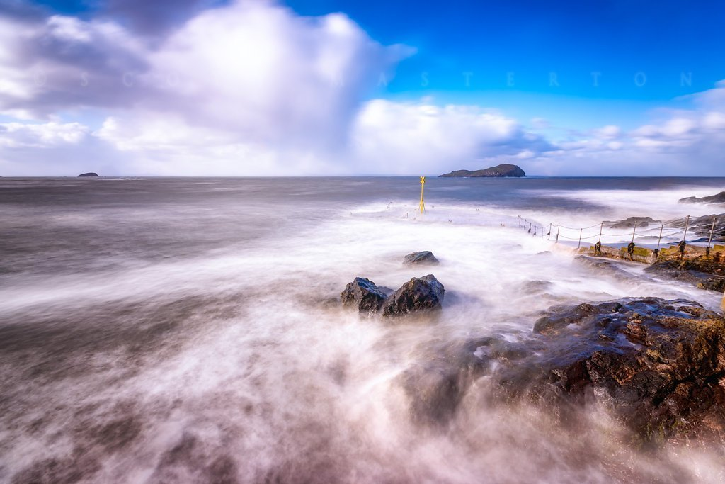 UK, Scotland, East Lothian, North Berwick, winter storm and waves crashing into the coast.