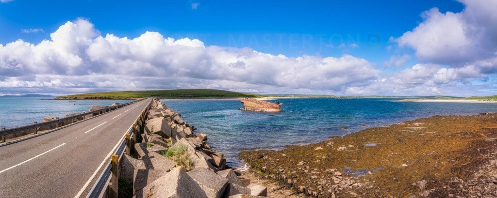 Scotland, Orkney Islands, view of one of the Churchill Barriers between the islands of Burray and Glimp Holm, with a 'block ship' shown partially submerged on the right hand side.