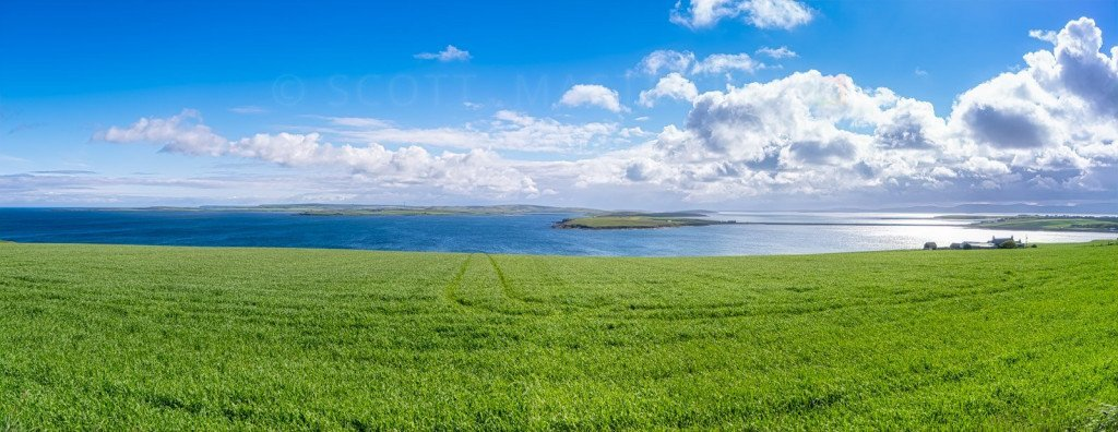Scotland, Orkney Islands, view over Kirk Sound and towards one of the Churchill Barriers on the right hand side and towards Scapa Flow beyond.
