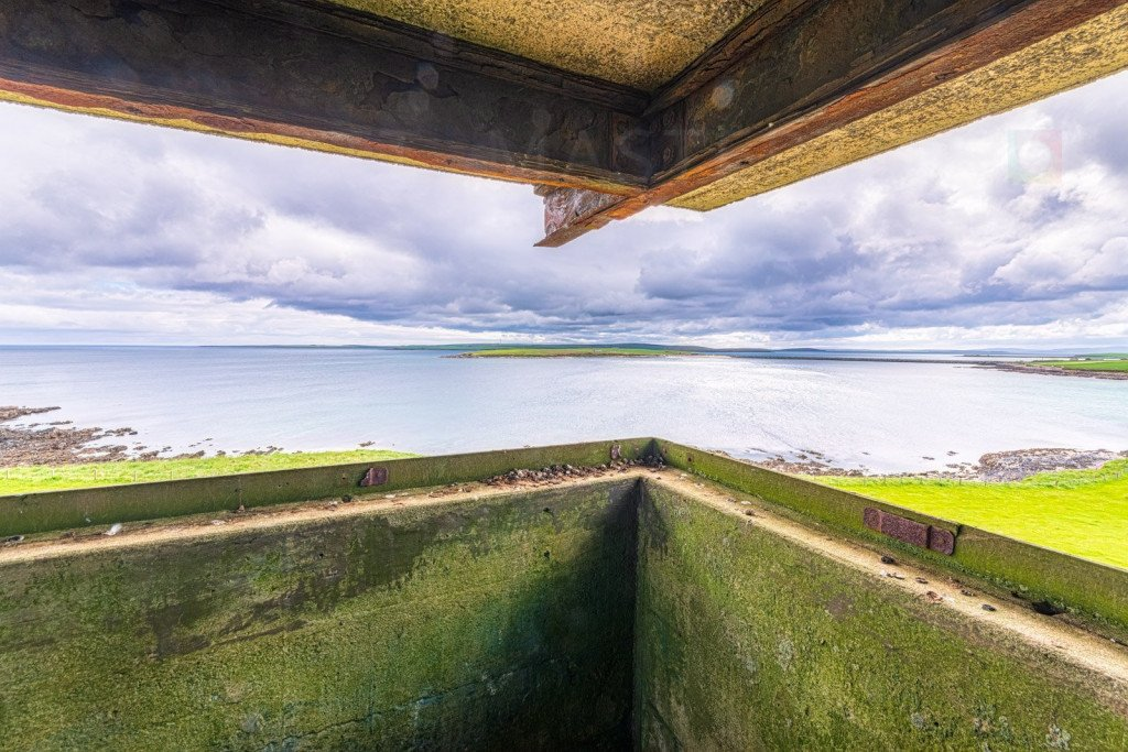Scotland, Orkney Islands, view from World War II military lookout post over Kirk Sound and towards one of the Churchill Barriers on the right hand side and towards Scapa Flow beyond. This is the route through which the German U Boat U-47 passed on14 October 1939 and then sunk HMS Royal Oak at anchor in Scapa Flow, before making its escape via the same route.